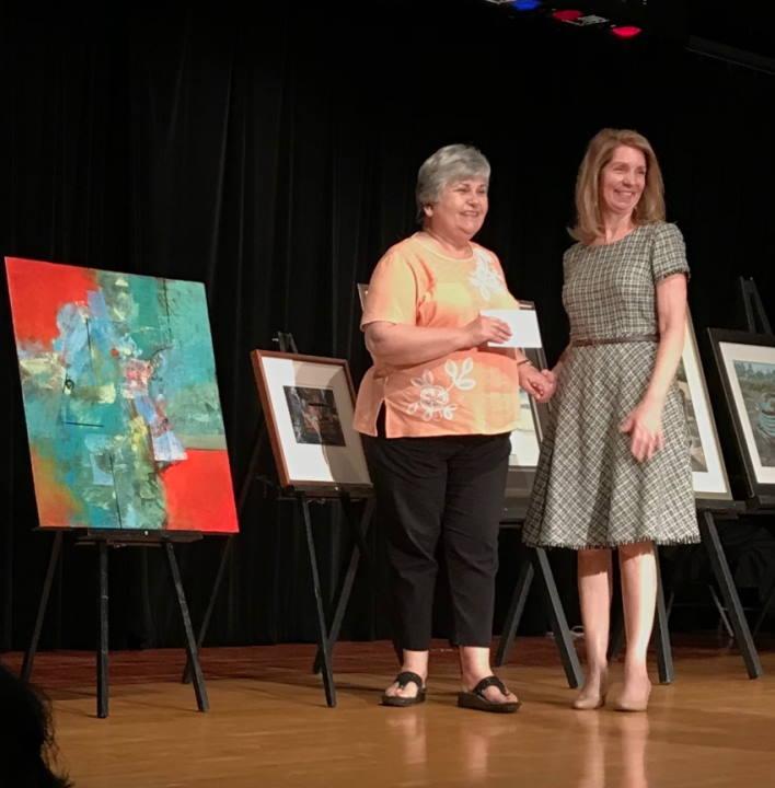 Ingrid Carson winning her award
