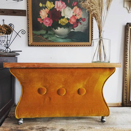 Totally unique upholstered occasional table with original burnt orange velvet