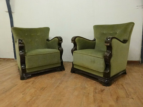 A pair of Danish stained beech lounge chairs with green velour upholstery.