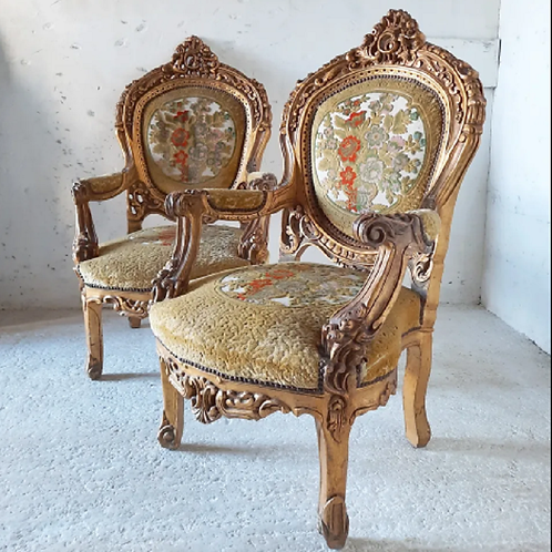 An Epic pair of straw filled Louis xv style chairs.