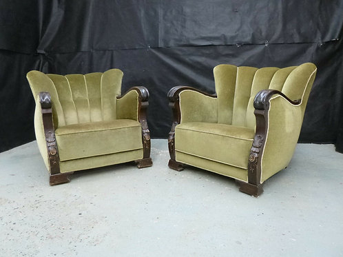A pair of Danish carved stained beech lounge chairs