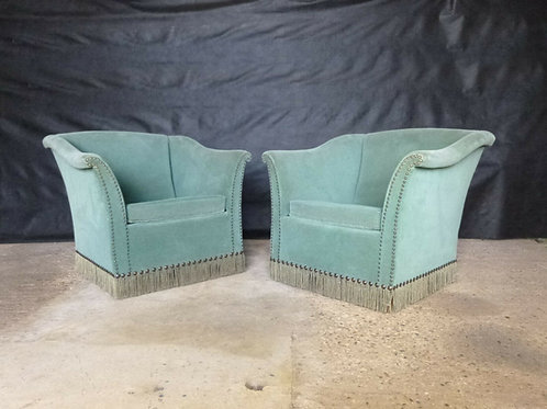 A pair of Danish spearmint green velour lounge chairs.