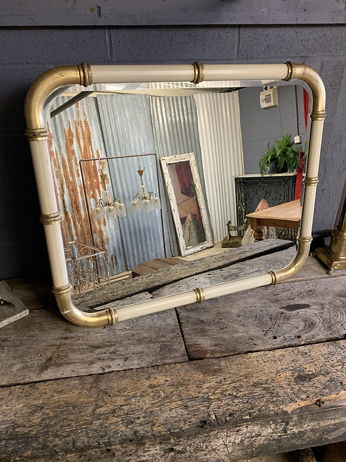 A Large Cream and Gold Hollywood Regency wall mirror
