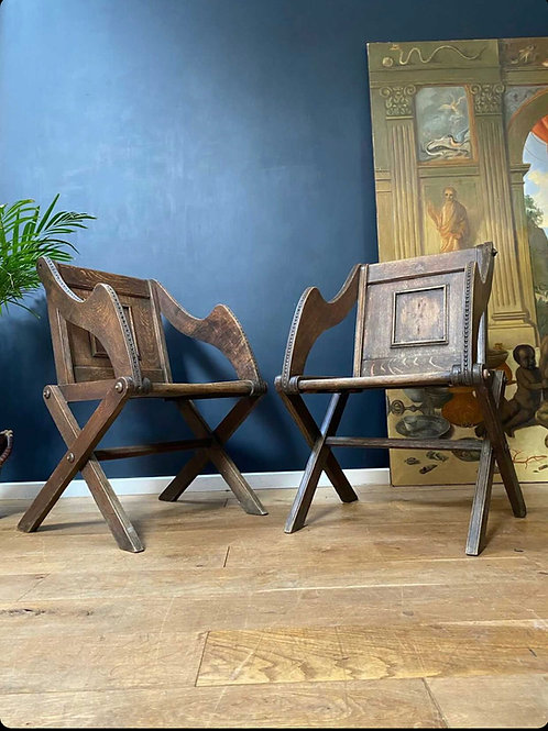 A well presented pair of Glastonbury armchairs