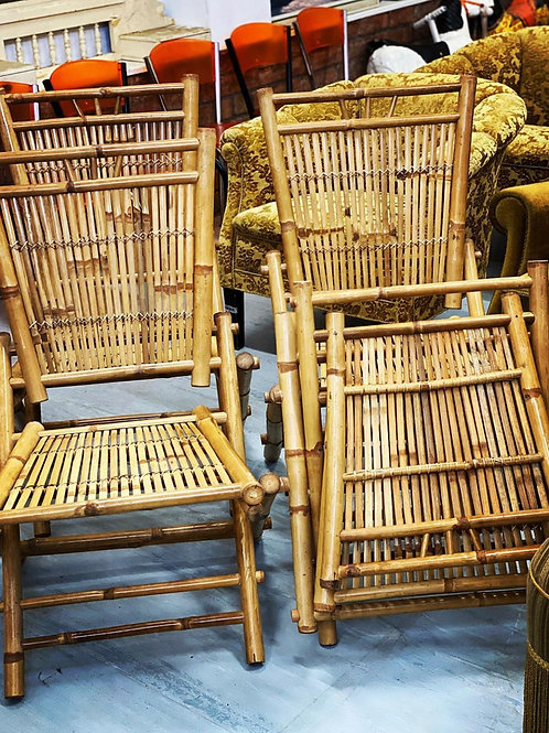 A stunning set of 4 unusual and rare vintage French bamboo folding chairs.