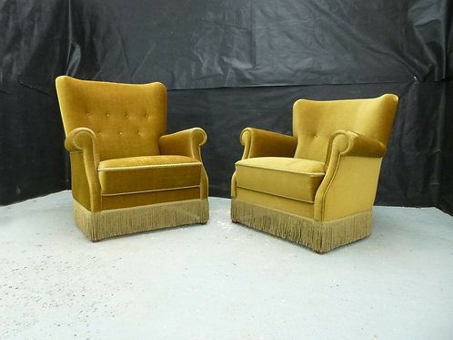 A pair of Danish high and low-backed lounge chairs with khaki velour upholstery.