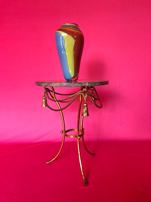A classic gilt metal and serpentine marble tripod occasional table