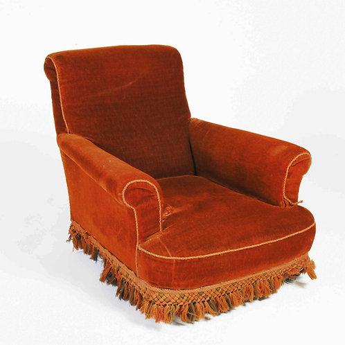 A 19th century walnut carpet/ velvet upholstered armchair