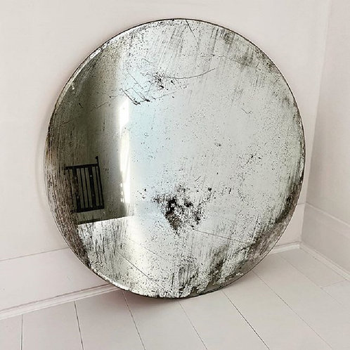 A large heavily foxed circular mirror plate