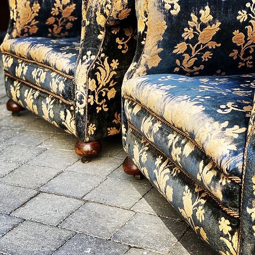 A large pair of Howard Style early 20th century country house armchairs