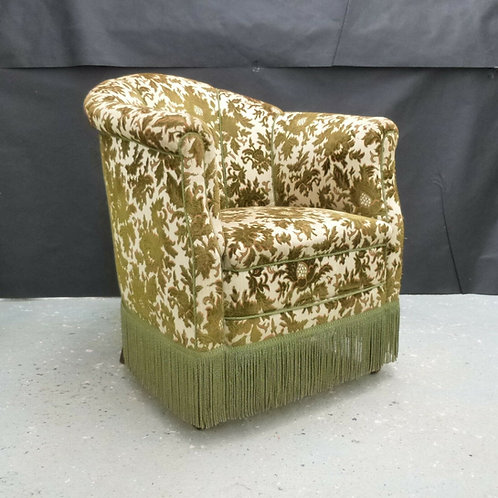 Napoleon III style lounge chair with green fringed velour upholstery