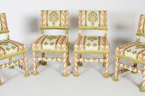 A stunning set of four upholstered occasional chairs