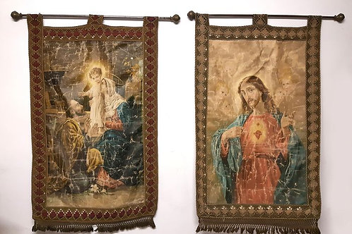 2 Fabric Religious Banners decorated with trimmings and metal sticks.