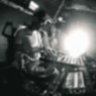 A DJ performing in a nightclub on Pioneer Decks