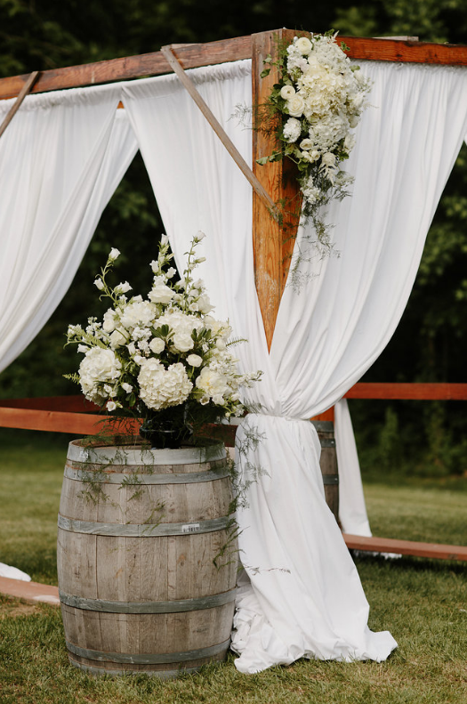 white altar arrangements and arbor