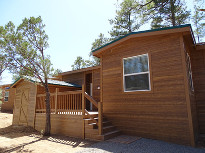 Added Deck Space with Attached Shed On Side of Home