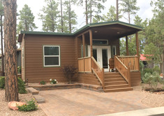 Home with living room addition and paver driveway
