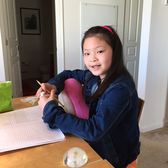 Asian Girl with Paperweight.jpeg