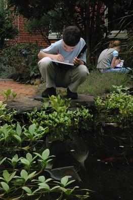 Boy Crouched @ Koi Pond.jpeg