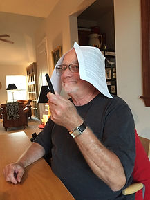 Man with paper on head.jpg