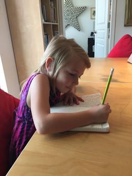 Blonde Girl Writing @ Table.jpeg