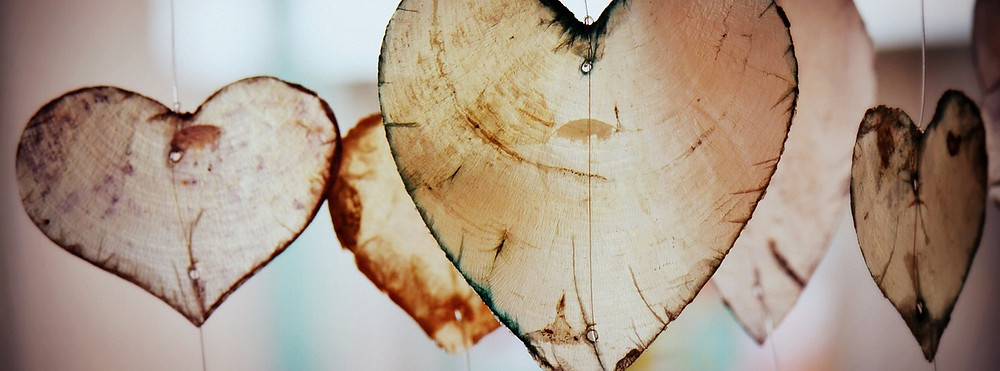wooden hearts hanging in light