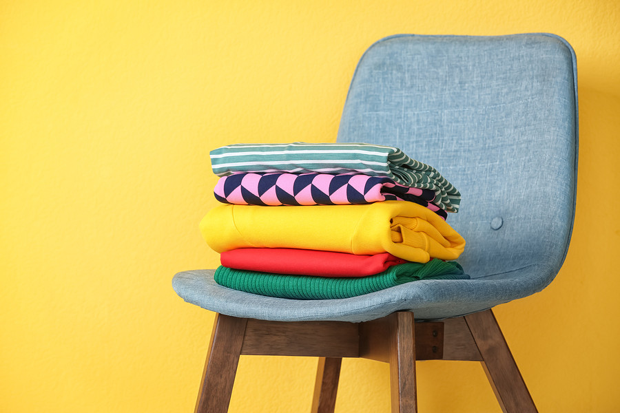chair with folded shirts