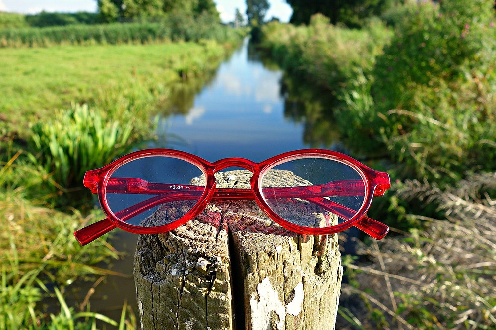 red glasses on post