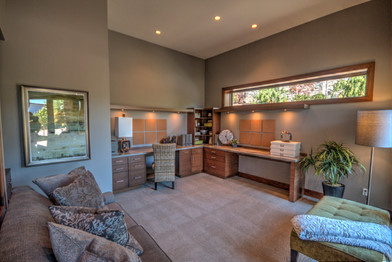 The den, with built in desks, is right off the entry and also open to the great room.