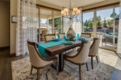 Sophisticated neutrals,  bright accents colors and metallic accessories make for a dramatic dining room