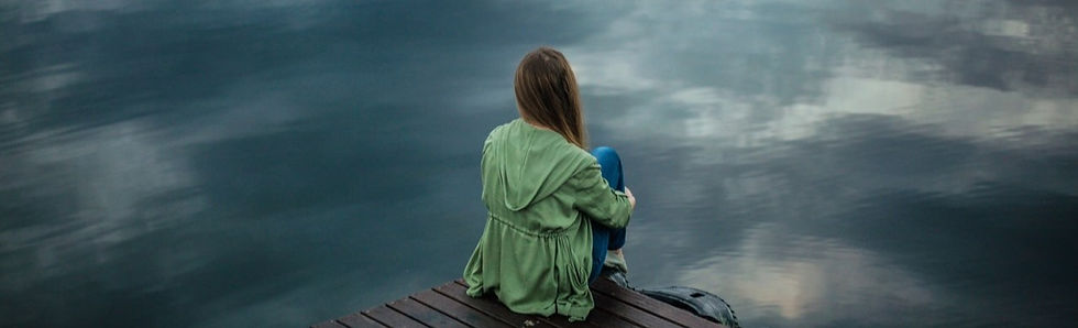 woman sitting on a dock.jpg