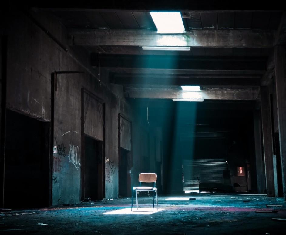 sunlight on chair in dark room