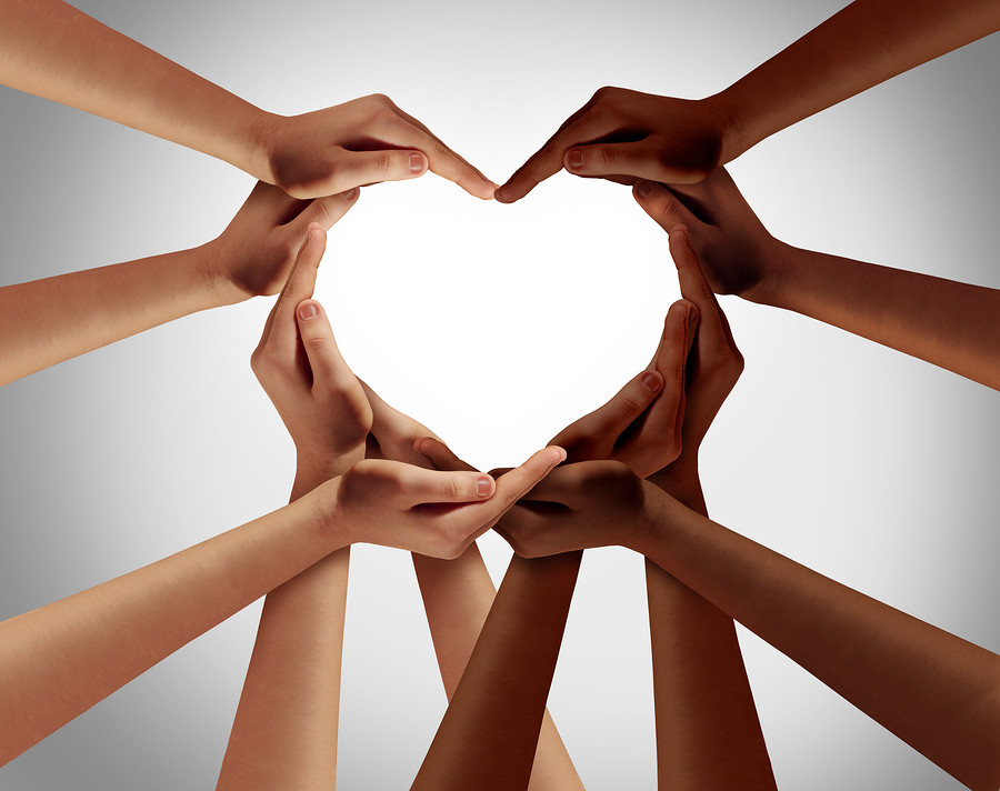 racial hands forming a heart