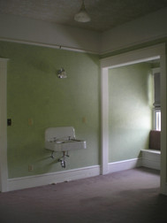 Each of the four upstairs bedrooms had these sinks hanging on the walls. They looked kinda sad.