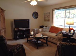 "Here's the ho-hum ""Before"" living room with a bi-i-i-g blank wall."
