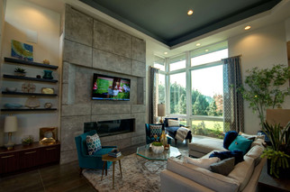 The focal point of the great room was the floor to ceiling, concrete-look fireplace.