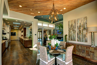 We brought in lots of organic touches with wood ceilings and rustic finishes on the furniture.