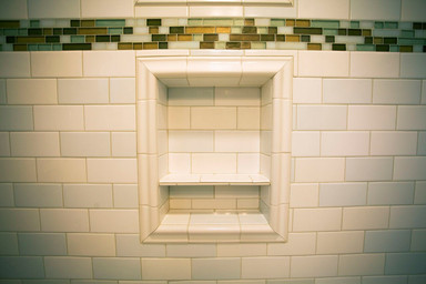 Shower niches added extra storage - - and a lot of detail work by the installer!