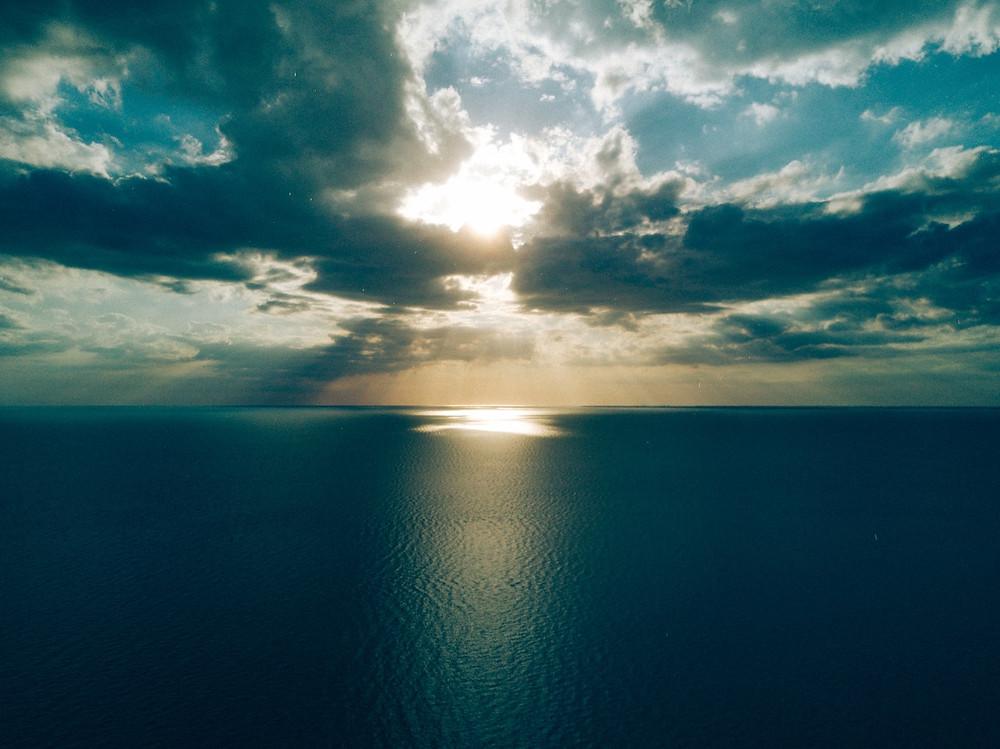 sunset over blue ocean