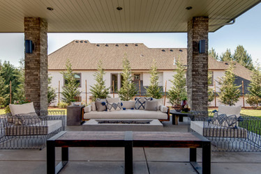 Outdoor living with an open fire pit and wire cage furniture
