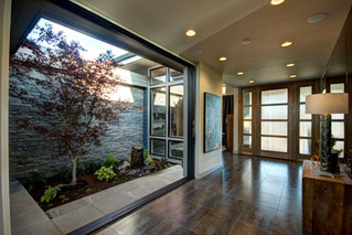 The house featured an atrium with a gurgling fountain and sliding doors that opened the great room to the outdoors.