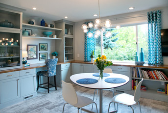 The dining room table was moved to another room, and plenty of cabinetry was added to accommodate a new buffet area and a dedicated space for cookbooks.
