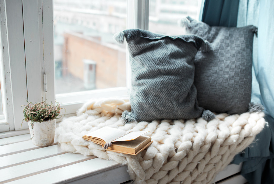 window seat with pillows and a book