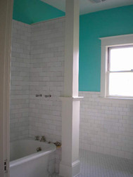 Here's the nearly completed shower with the blended white subway tile. We were able to keep the original tub, but it was a challenge.