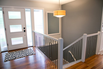 The front door was moved to the center of the area, and now it's a spacious welcoming entry to the house.