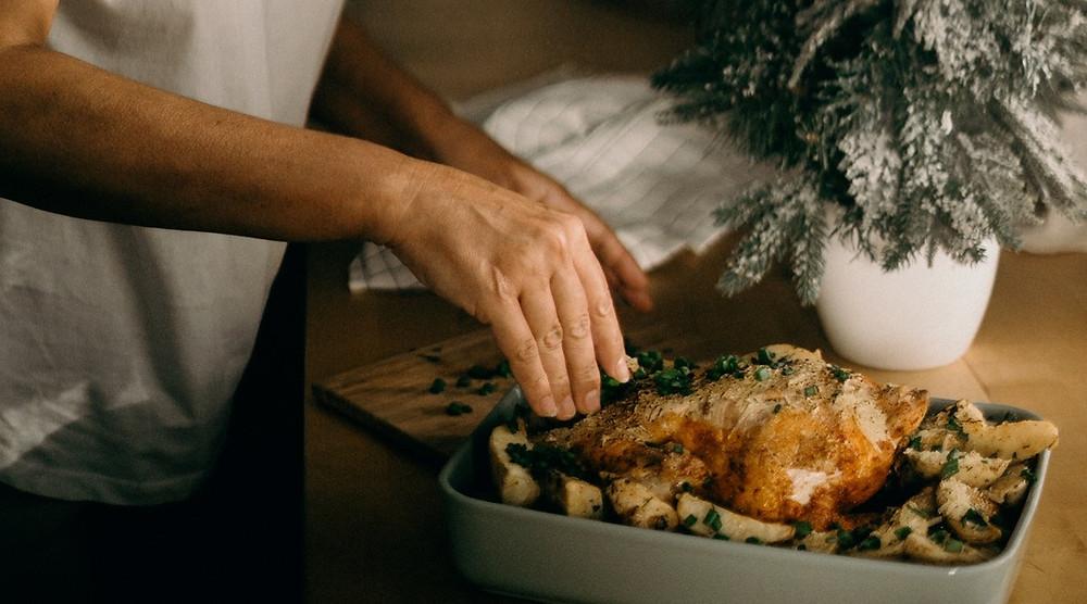 hands preparing dinner