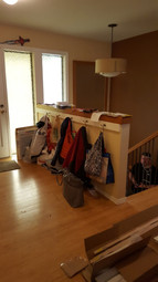 The old entry featured amber glass and a pony wall full of coats and backpacks.