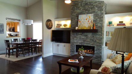 The carpet was replaced with beautiful distressed hardwood floors in the living room and into the dining room.