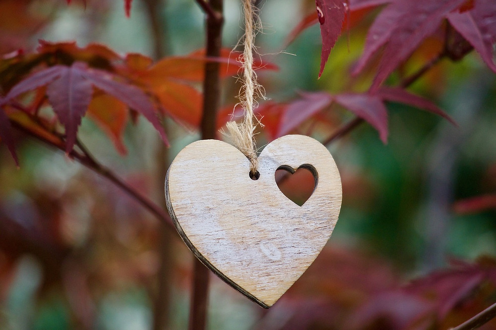 wooden heart with fall leaves