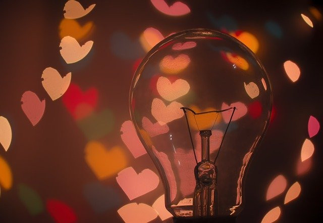 light bulb with swirling hearts